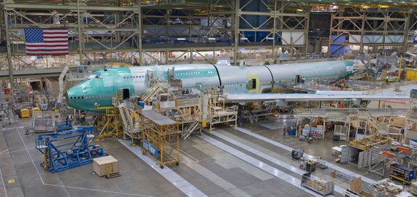 The fuselage of a Boeing 747-8 Intercontinental is put together in the manufacturing step known as final body join at Boeing's Everett, Wash., plant. For the second time this year, Boeing this month curtailed production of the new 747-8, citing weak demand. Though Boeing spokesmen insist there are no plans to retire the 747, experts point to growing signs that the fuel-guzzling plane is finished.