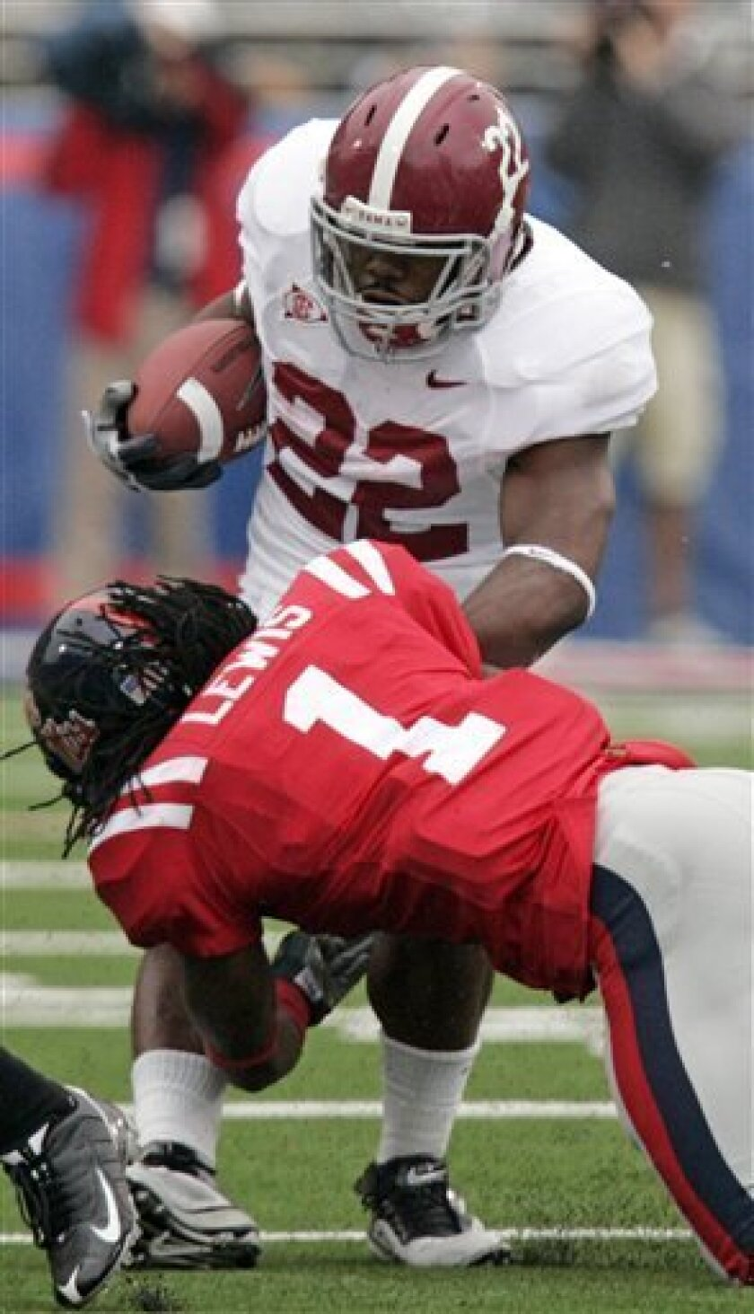 Alabama running back Mark Ingram (22) is tackled by Mississippi safety Kendrick Lewis (1) during the first quarter of an NCAA college football game in Oxford, Miss., Saturday, Oct. 10, 2009. (AP Photo/Rogelio V. Solis)