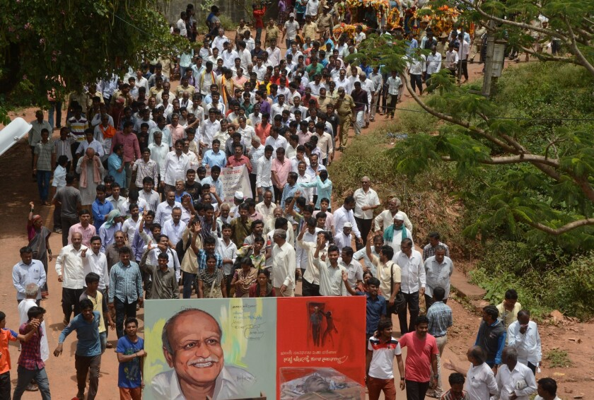 Indian mourners follow the funeral procession for scholar M.M. Kalburgi as his body is taken to be buried at Karnataka University in Dharwad, India, on Aug. 31, 2015.