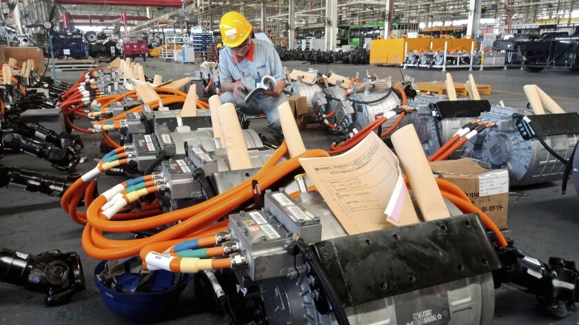 In this Aug. 29, 2018, photo, a man works in an auto parts factory in Liaocheng in eastern China's S