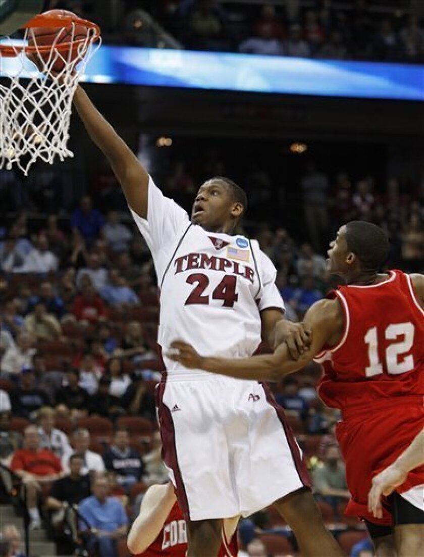 Temple's Lavoy Allen (24) goes for a basket as Cornell's Louis Dale (12) defends during an NCAA first-round college basketball game in Jacksonville, Fla., Friday, March 19, 2010.  (AP Photo/Steve Helber)