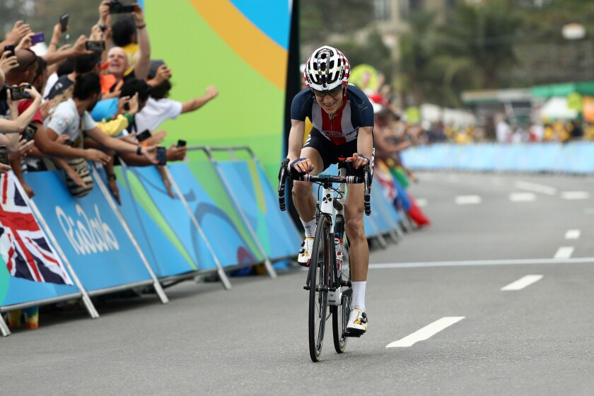 U.S. cyclist Mara Abbott crosses the finish line in fourth place in the women's road race at the Rio Olympic Games on Aug. 7.