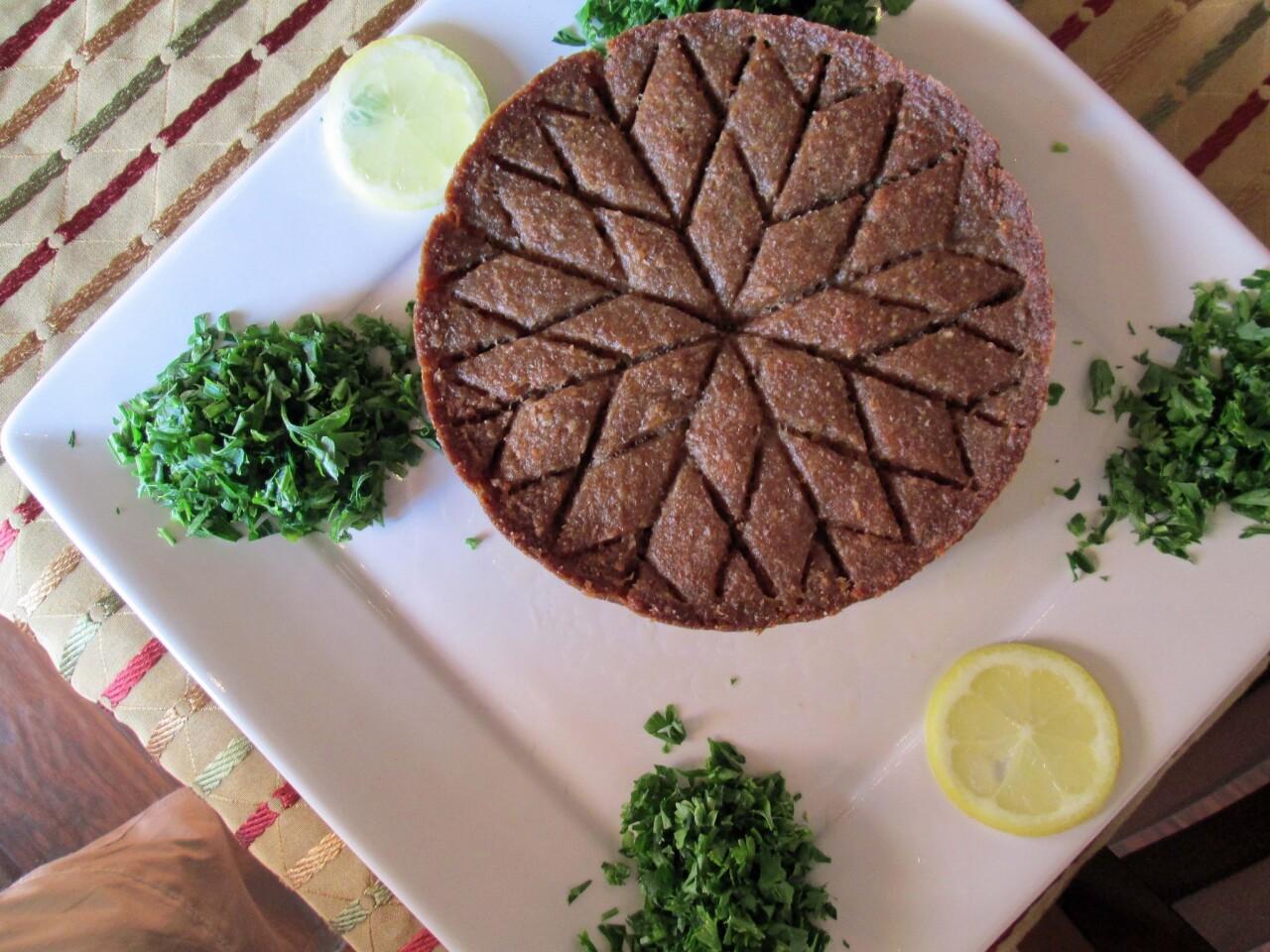 Kibbeh bil seniyeh is baked in a pan.