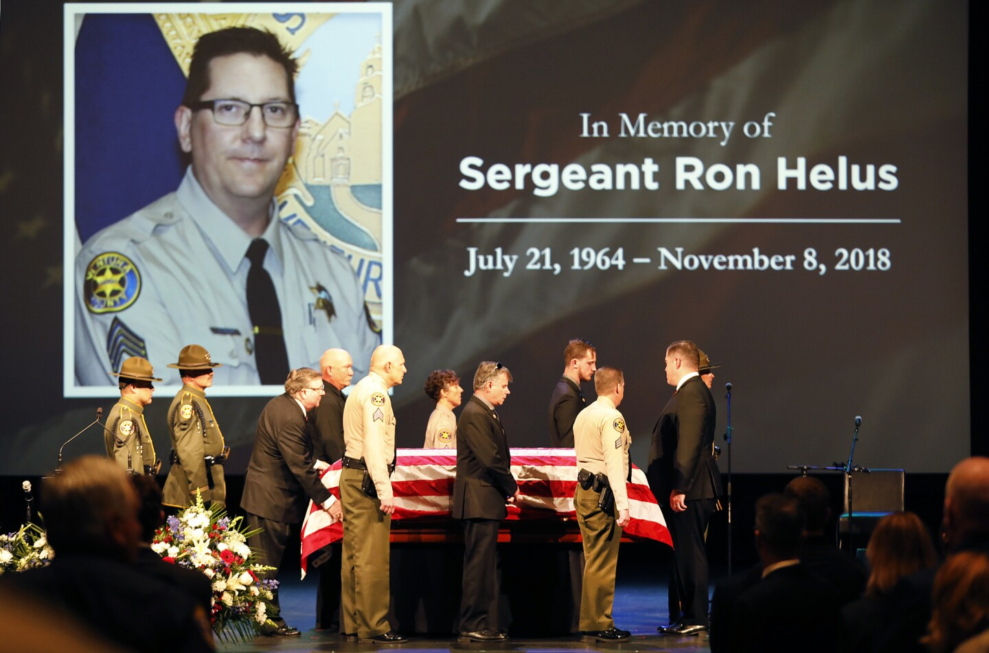The flag-draped casket of Ventura County Sheriff's Sgt. Ron Helus arrives onstage for a memorial service Thursday at Calvary Community Church in Westlake Village.