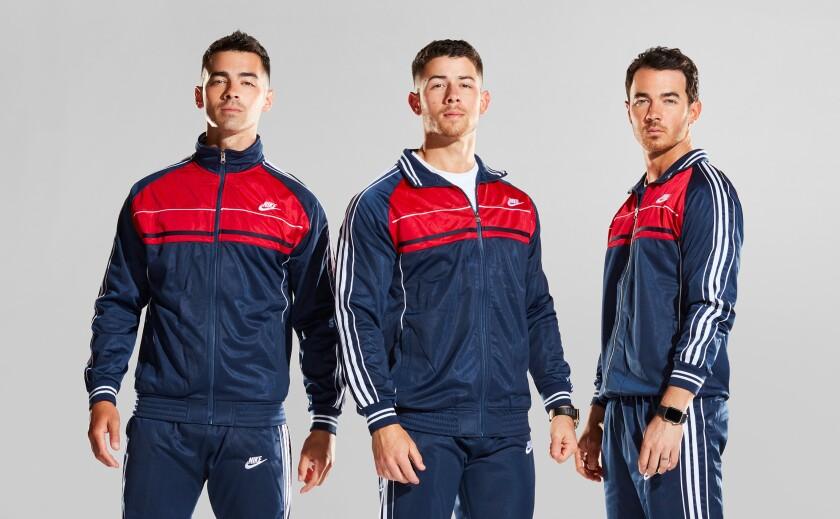 Joe Jonas, Nick Jonas and Kevin Jonas sport matching track suits
