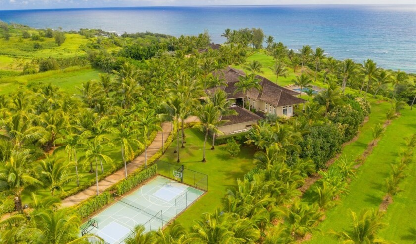Spanning five coastal acres, the estate holds a plantation-style home, covered lanai, detached gym and swimming pool overlooking the ocean.
