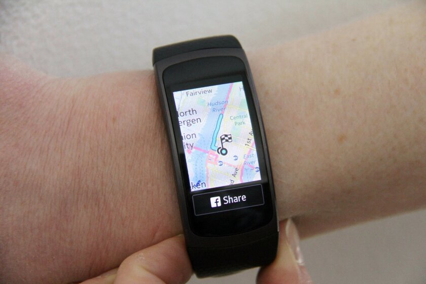 In this Monday, May 23, 2016, photo, features on the Fit2 are demonstrated, in New York. The Fit2 has GPS tracking and records your running route on a map, in addition to providing distance and pace information during workouts. (AP Photo/Anick Jesdanun)