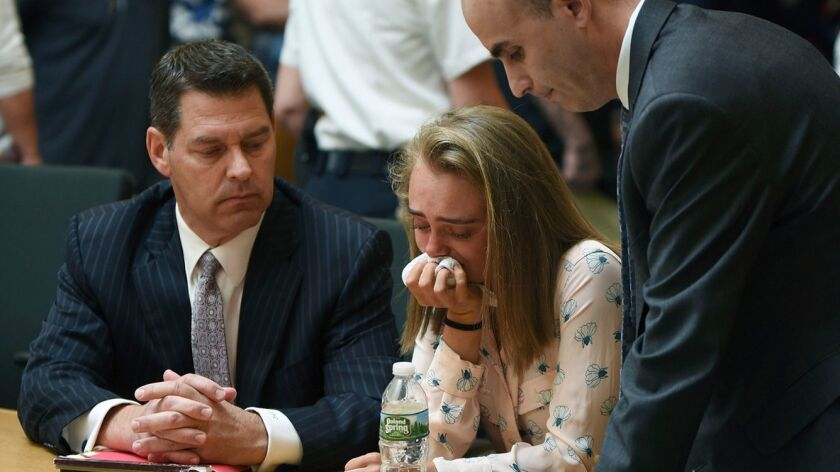 Michelle Carter cries while flanked by defense attorneys Joseph Cataldo, left, and Cory Madera, afte