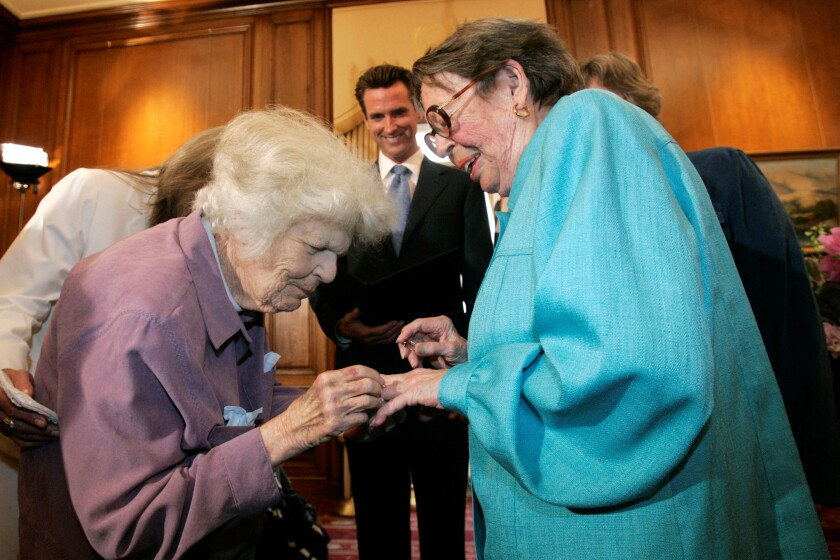 Del Martin, left, places a ring on the finger of Phyllis Lyon during their June 16, 2008, wedding ceremony at San Francisco City Hall.