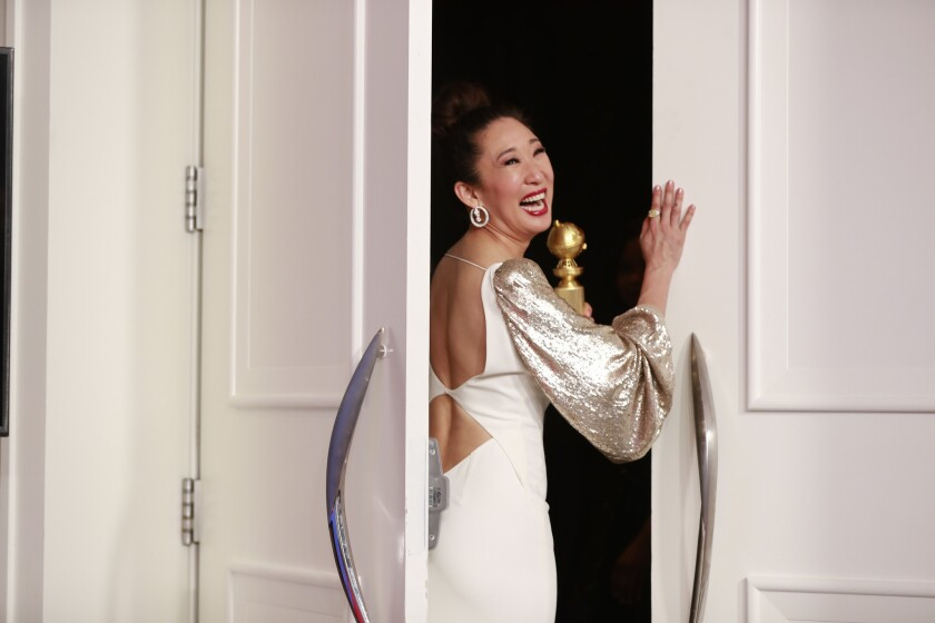 """BEVERLY HILLS, CA-JANUARY 06: Sandra Oh of """"Killing Eve"""" after winning for Best Performance by an Ac"""