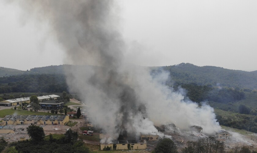 Smoke billows from a fire following an explosion at a fireworks factory outside the town of Hendek, Sakarya province, northwestern Turkey, Friday July 3, 2020. There were an estimated 150 workers at the factory, Gov. Cetin Oktay Kaldirim told state-run Anadolu Agency. Several firefighters and ambulances were sent to the factory, which is away from residential areas, but explosions continued to hamper efforts to bring the fire under control. The cause of the blast wasn't immediately known. (IHA via AP)