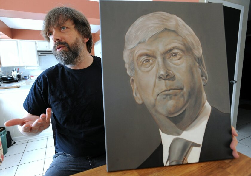 Artist Michael Dykehouse explains the process and politics behind his recent painting of Governor Rick Snyder made using lead-based paint at his home in Ann Arbor, Mich., on Wednesday, Feb. 17, 2016.  Dykehouse used white paint that's made with lead in the painting as a permanent reminder of childr