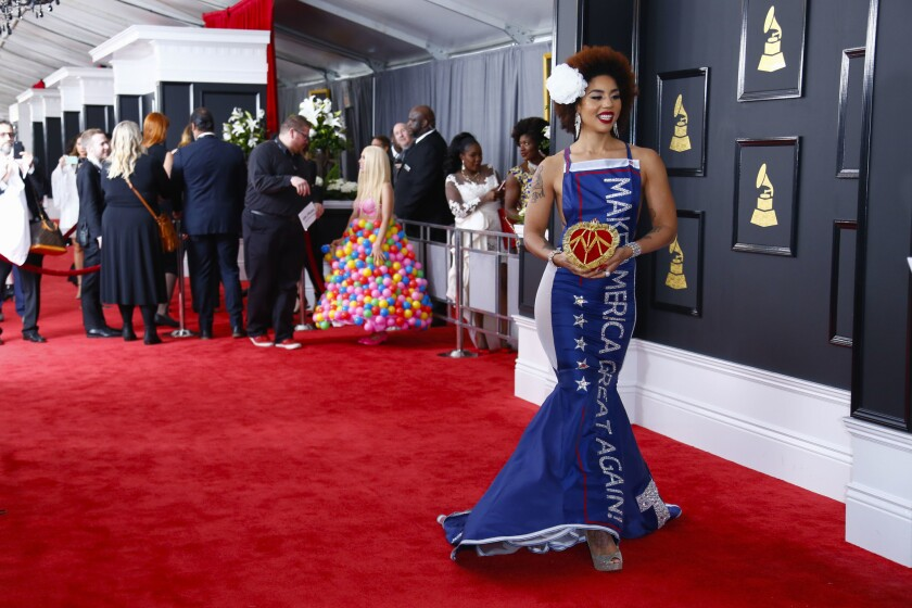 """Singer Joy Villa wears a """"Make America Great Again"""" TRUMP dress during the arrivals at the 59th Annual Grammy Awards."""