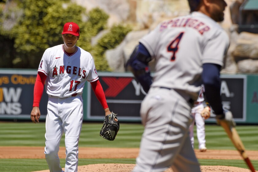 Angels pitcher Shohei Ohtani reacts after walking Houston's George Springer with the bases loaded.