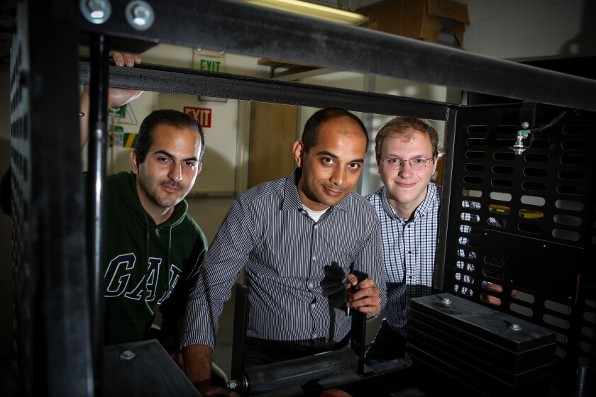 Three members of the UCLA Carbon X-Prize team in their laboratory.