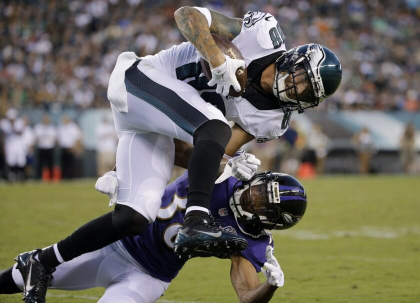 Philadelphia Eagles' Jeff Maehl (88) collides with Baltimore Ravens' Rashaan Melvin after a catch during the first half of a preseason NFL football game, Saturday, Aug. 22, 2015, in Philadelphia. (AP Photo/Matt Rourke)