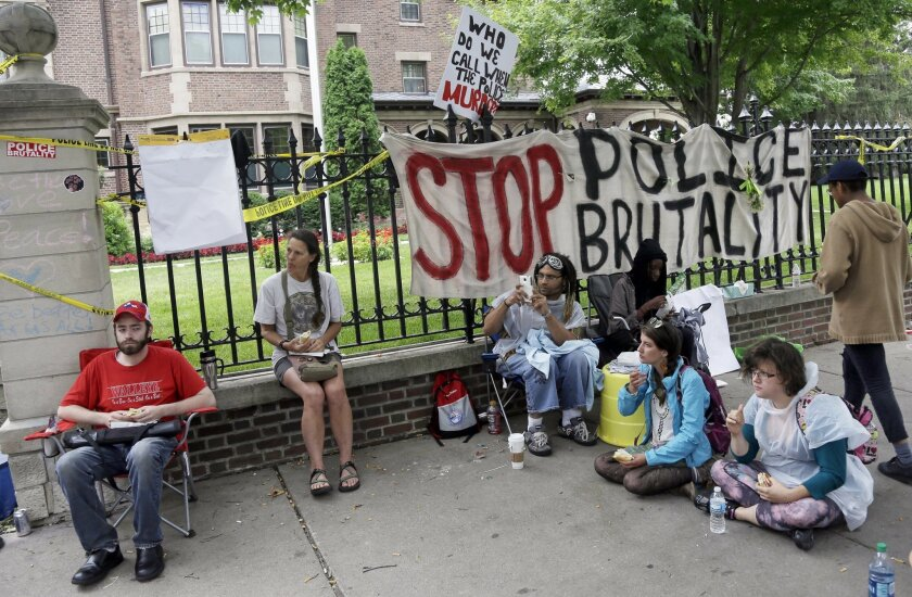 Demonstrators gather outside the governor's residence Friday, July 8, 2016, in St. Paul, Minn., where protests continue over the shooting death by police of Philando Castile after a traffic stop Wednesday, July 6, in Falcon Heights.  (AP Photo/Jim Mone)