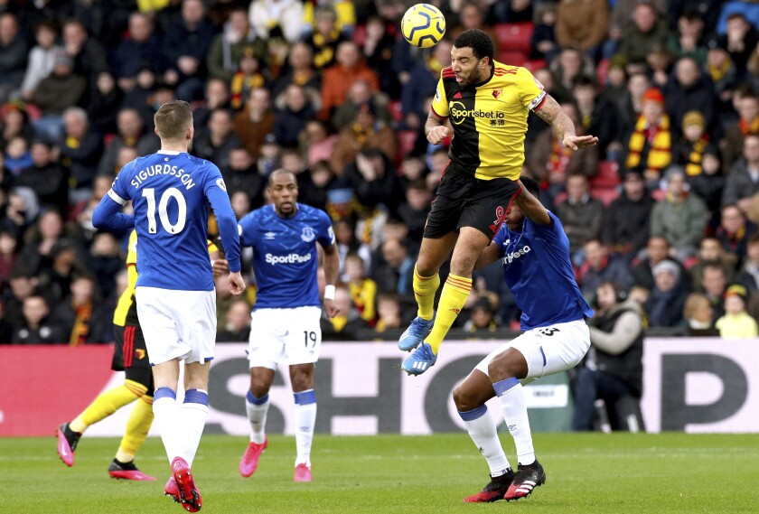 Watford's Troy Deeney, top right, heads the ball during the match against Everton during the English Premier League soccer match at Vicarage Road in Watford, England, Saturday Feb. 1, 2020. (Jonathan Brady/PA via AP)