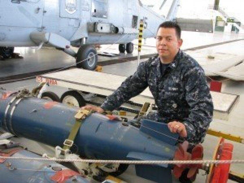 Navy Aviation Ordnanceman Second Class (AO2) Anthony Ugolini