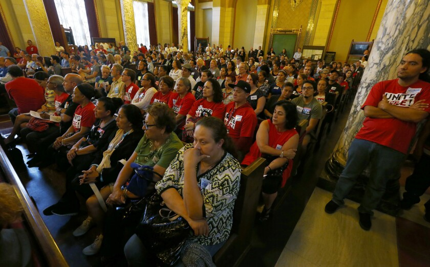 An overflow crowd fills the L.A. City Council chamber Thursday as the Planning Commission considered imposing new regulations on Airbnb and other websites.