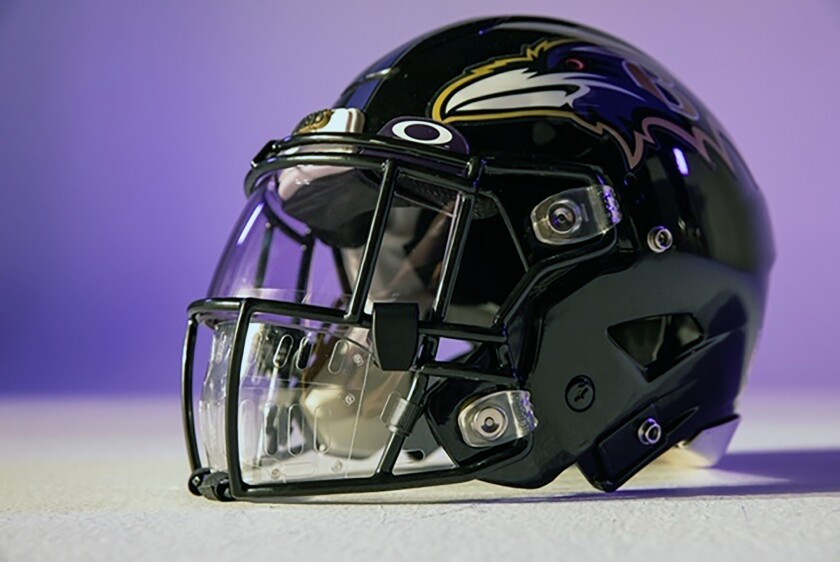 An NFL helmet features a face shield intended for players' protection amid the coronavirus crisis