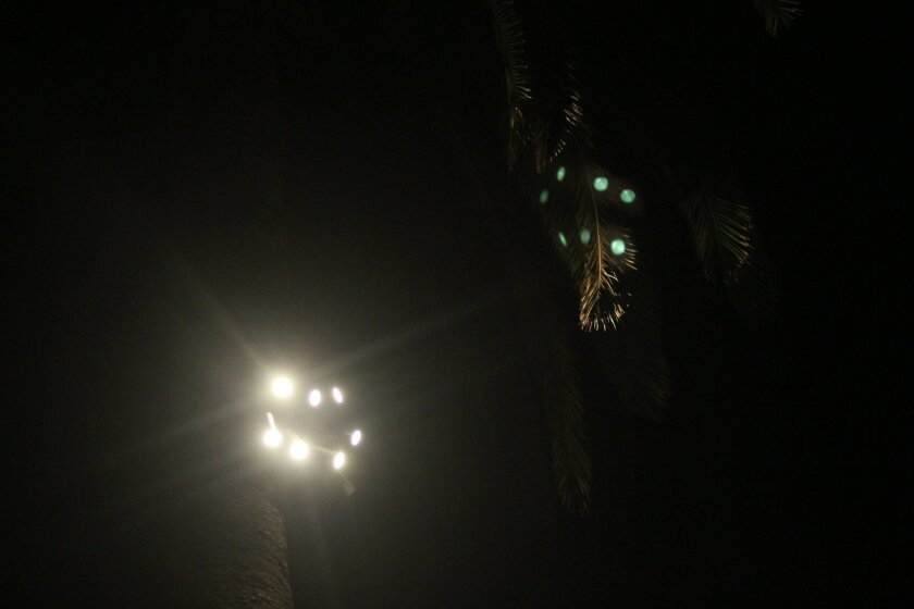 Residents of Devonshire House complained that one of these outdoor cluster lights illuminating a plaza at St. James by-the-Sea church on Prospect Street has been shining over the church and into their fourth-floor windows at night.