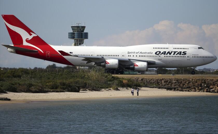 Qantas airliner taxiing on airport runway