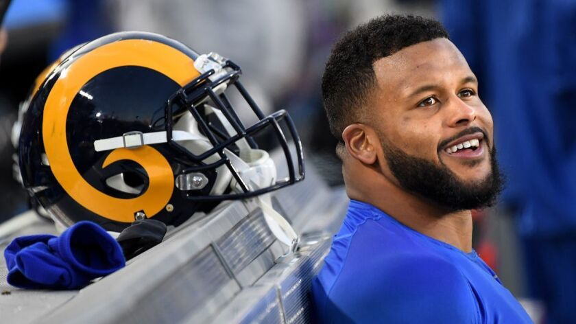 Rams defensive tackle Aaron Donald sits on the bench late in the fourth quarter during a game against the San Francisco 49ers on Dec. 30 at the Coliseum.