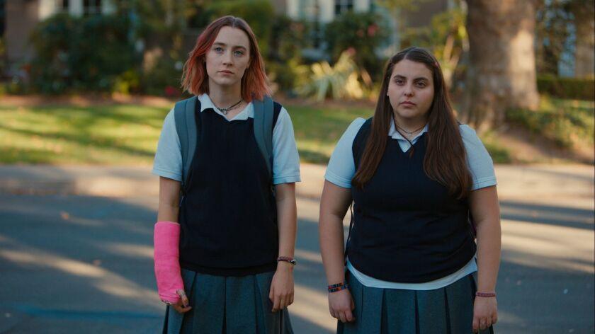 "(L-R)- Saoirse Ronan and Beanie Feldstein in a scene from the movie ""Lady Bird."" Credit: A24"