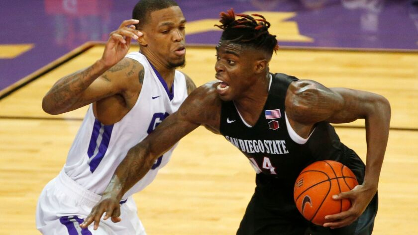 Aztecs forward Zylan Cheatham looks to shoot against Grand Canyon forward Darion Clark during the second half. Cheatham had 17 points, one off his career high, while playing in his hometown of Pheonix.