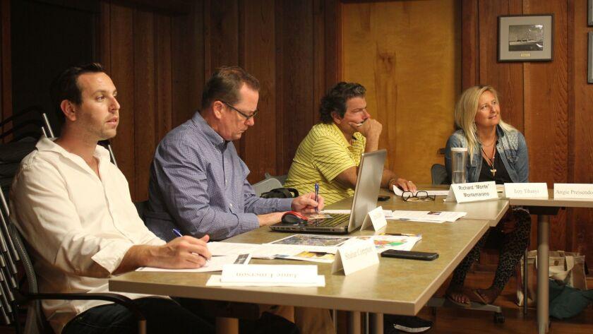La Jolla Shores Association board members Shahar Compton, Brian Earley, Richard Montemarano and Izzy Tihanyi listen to the lifeguard report.