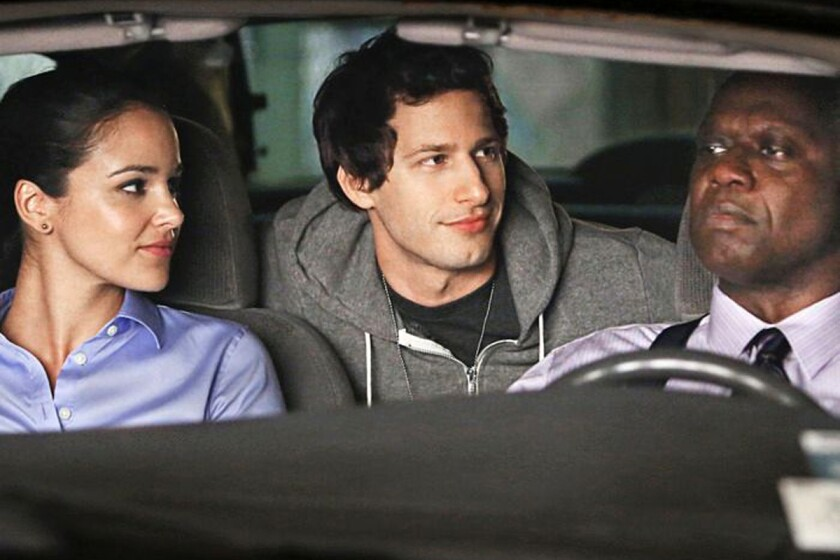 "Melissa Fumero, Andy Samberg, center, and Andre Braugher in ""Brooklyn Nine-Nine."""