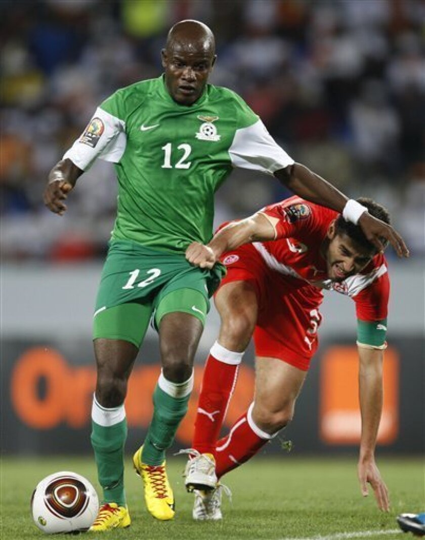 Tunisia's Karim Haggui, right, challenges Zambia's James Chamanga for the ball during their African Cup of Nations Group D soccer match at Tundavala Stadium in Lubango, Angola Wednesday, Jan. 13, 2010. (AP Photo/Rebecca Blackwell)