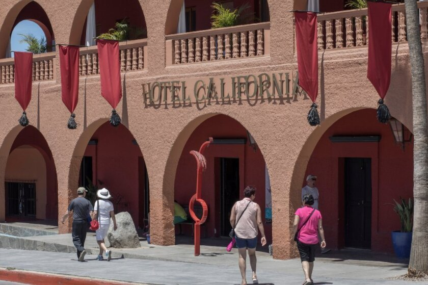 FILE PHOTO: Tourists walk past Hotel California in the town of Todos Santos, Baja California Sur, Mexico, May 2, 2017.