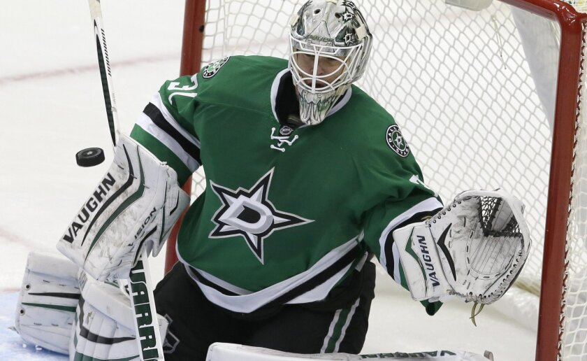 Dallas Stars goalie Antti Niemi blocks a shot during the third period of an NHL hockey game against the San Jose Sharks, Saturday, Oct. 31, 2015, in Dallas. (AP Photo/LM Otero)