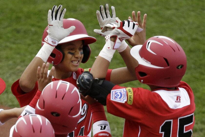 Tijuana's Brandon Montes celebrates with teammates after hitting a home run against Australia on Thursday, but the Mexican champs aren't all about hitting.
