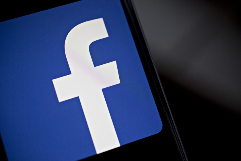 """Facebook is discontinuing its troubled """"trending"""" section, the social network announced Friday."""