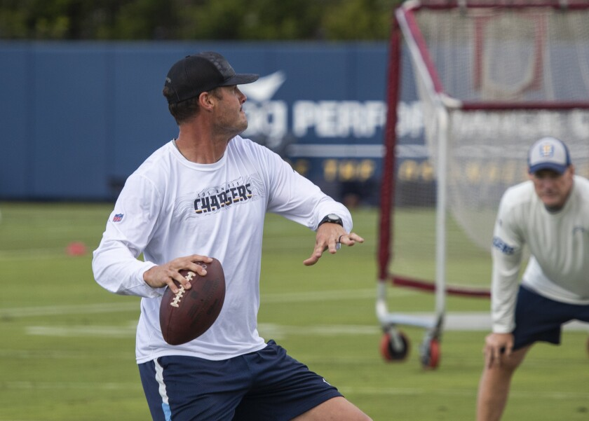 Philip Rivers, shown here in spring camp, had a busy two days against the Rams.