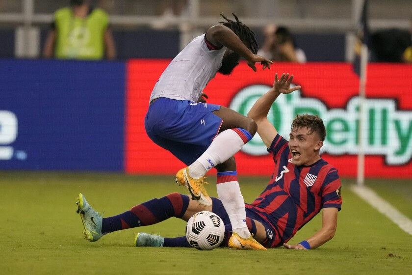United States defender Sam Vines (3) and Haiti defender Stephane Lambese, left, battle for the ball during the first half of a CONCACAF Gold Cup soccer match Sunday, July 11, 2021, in Kansas City, Kan. (AP Photo/Charlie Riedel)