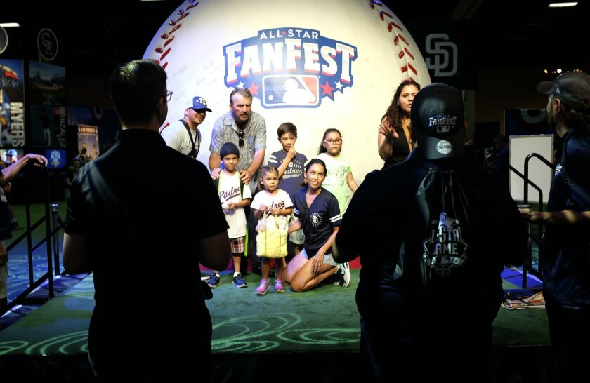 The Mencia family poses for a photo at the World's Largest Baseball at MLB All-Star FanFest, at the San Diego Convention Center through July 12.