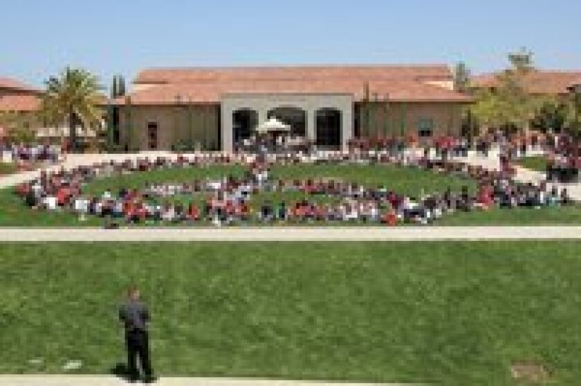 Cathedral Catholic High School recently held a day of prayer for peace in Africa. During lunch on April 20, the Cathedral Catholic High School student body gathered on the school's grassy area forming a large human peace sign. Students remained in the peace sign as a service of prayer and song took place.
