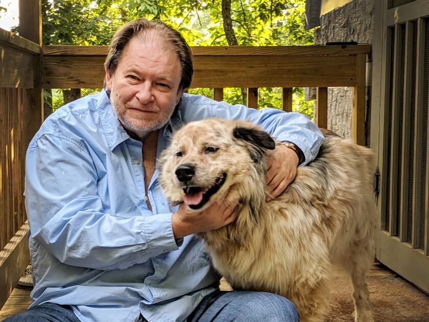Pulitzer Prize-winning journalist and author Rick Bragg sheltering in Alabama with his dog, Speck.