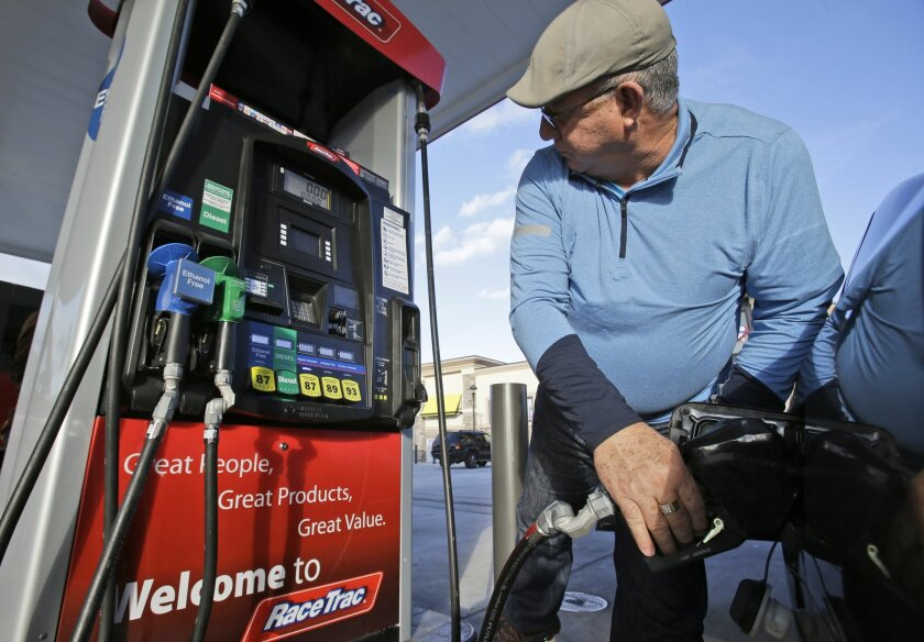 A report released Tuesday by the U.S. Energy Information Administration predicts drivers across the country will pay less for gasoline this summer than last. That figures to be the same for California drivers, too. (AP Photo/Wilfredo Lee, File)