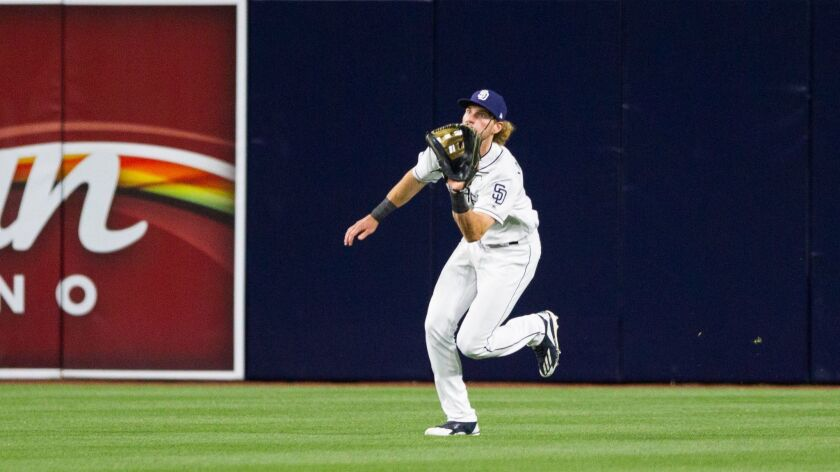 San Diego Padres center fielder Travis Jankowski catches a fly ball in the third inning.