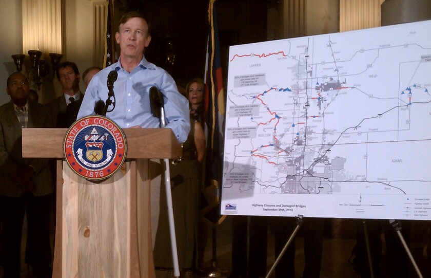 Colorado Gov. John Hickenlooper talks at a Denver news conference about the aftermath of last week's historic rains.