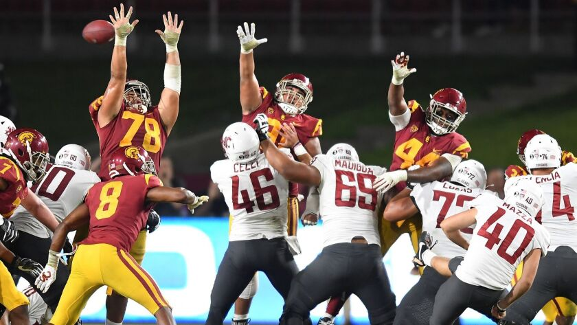 USC's Jay Tufele (78) blocks the field goal of Washington State kicker Blake Mazza to preserve the win in the fourth quarter at the Coliseum.