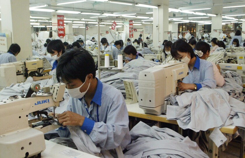 Workers sew shirts to be exported to the United States at Garment Company 10 outside Hanoi, Vietnam in 2007.