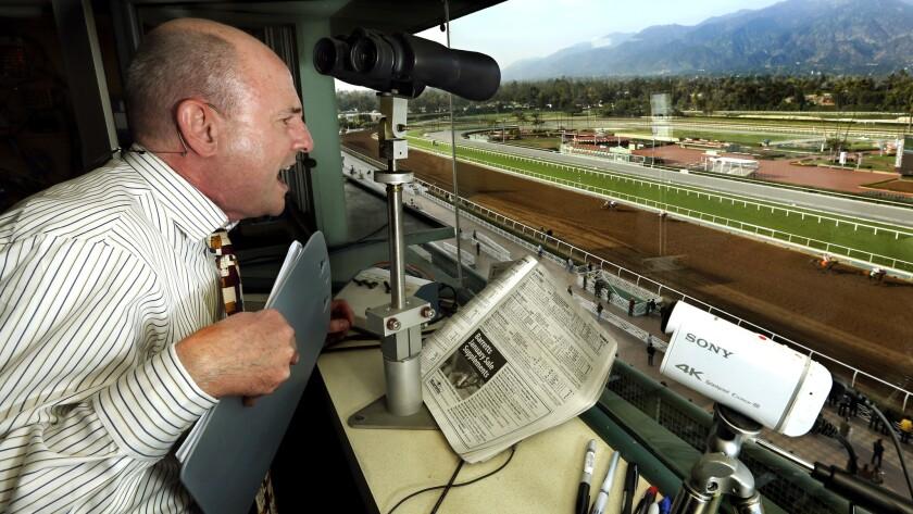 Michael Wrona calls a race at Santa Anita Park on Thursday afternoon.