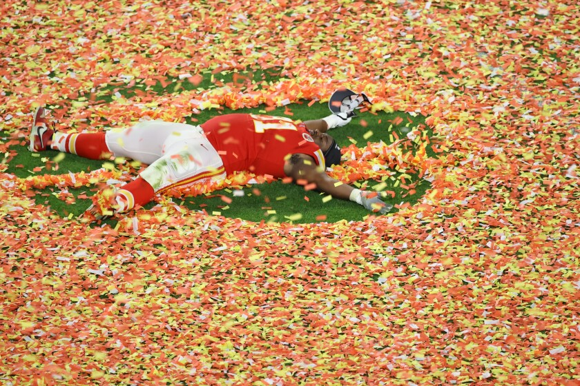 Derrick Nnadi of the Kansas City Chiefs creates a confetti angel after the victory.