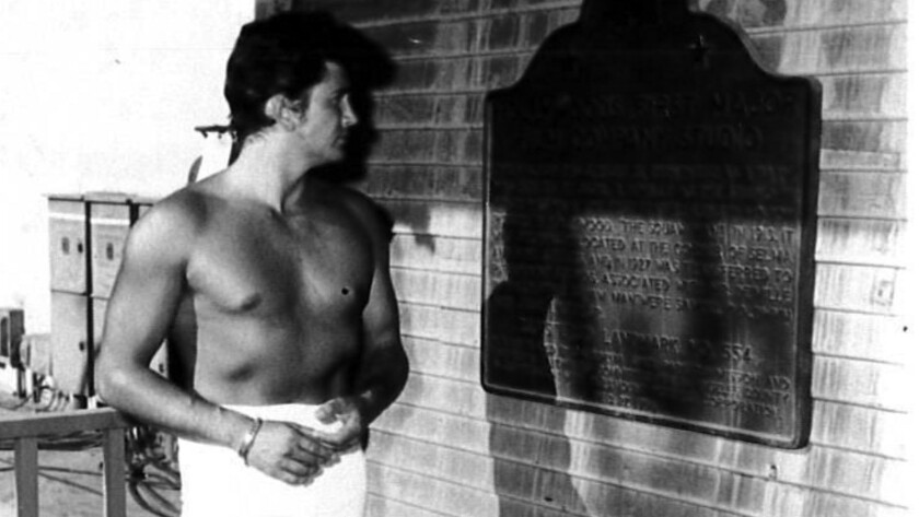 Michael Landon admires a plaque designating the old barn as a state landmark in the 1950s.